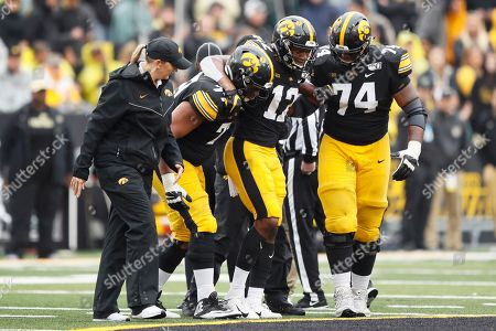 Brandon Smith, Alaric Jackson, Tristan Wirfs. Iowa wide receiver Brandon Smith (12) is helped off the field by teammates Alaric Jackson (77) and Tristan Wirfs (74) after getting injured during the second half of an NCAA college football game against Purdue, in Iowa City, Iowa. Iowa won 26-20