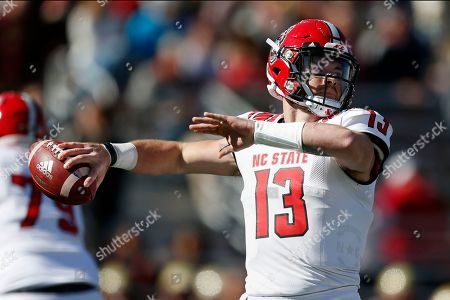 Stock Image of North Carolina State quarterback Devin Leary (13) passes against Boston College during the first half of an NCAA college football game in Boston