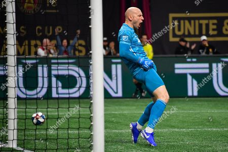 Atlanta United goalkeeper Brad Guzan reacts after blocking a shot during the first half of of an MLS Cup playoff soccer game against the New England Revolution, in Atlanta