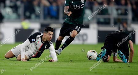 Juventus' Cristiano Ronaldo, left, is tackled by Bologna's Andrea Poli during a Serie A soccer match between Juventus and Bologna, at the Allianz stadium in Turin, Italy, Saturday, Oct.19, 2019