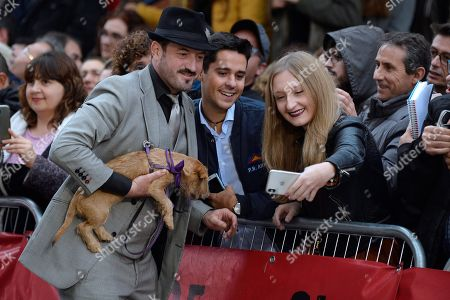 Stock Image of Alex O'Dogherty (L) poses with fans as he arrives to the opening of the 64th edition of the Seminci International Film Festival in Valladolid, Spain, 19 October 2019.