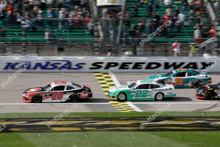 Christopher Bel, Austin Cindric, Brandon Jones. Christopher Bell (20) leads Austin Cindric (22) and Brandon Jones (19) during the first lap of an NASCAR Xfinity Series auto race at Kansas Speedway in Kansas City, Kan