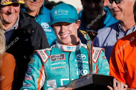 Brandon Jones (19) celebrates after winning a NASCAR Xfinity Series auto race at Kansas Speedway in Kansas City, Kan