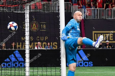 Atlanta United goalkeeper Brad Guzan guards the goal against a shot by the New England Revolution during round one of an MLS Cup playoff soccer game, in Atlanta. Atlanta United won 1-0
