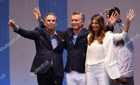 """Presidential candidate for """"Juntos Por el Cambio"""" party and Argentina's President Mauricio Macri, center, his wife Juliana Awada, right, and his running-mate Miguel Angel Pichetto, wave to supporters during a rally at """"9 de Julio"""" avenue in Buenos Aires, Argentina, . Argentina will hold its presidential election on Oct. 27"""