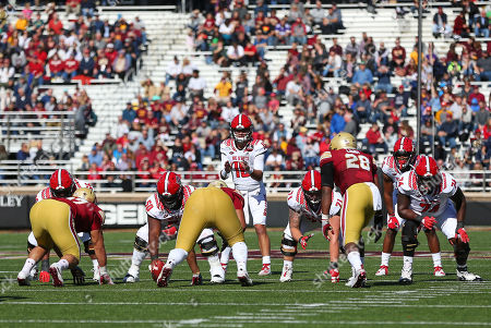 Stock Picture of Chestnut Hill, MA, USA; NC State Wolfpack quarterback Devin Leary (13) in action during the NCAA football game between North Carolina State Wolfpack and Boston College Eagles at Alumni Stadium