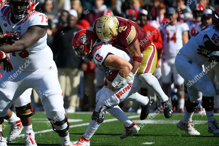 Boston College Eagles linebacker Max Richardson (14) rides North Carolina State Wolfpack quarterback Devin Leary (13) down for a sack during the NCAA division 1 game between the North Carolina State Wolfpack and the Boston College Eagles held at Alumni Stadium in Chestnut Hill, Mass