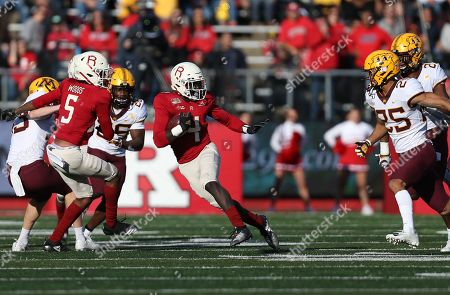 Rutgers Scarlet Knights running back Aaron Young (4) avoids the defense during an NCAA Men's football game between the Minnesota Golden Gophers and the Rutgers Scarlet Knights at SHI Stadium in Piscataway, NJ
