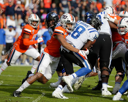 Virginia Cavaliers OLB #14 Noah Taylor sacks Duke Blue Devils QB #18 Quentin Harris to turn the ball over on downs during NCAA football game between the University of Virginia Cavaliers and the Duke Blue Devils at Scott Stadium in Charlottesville, Virginia