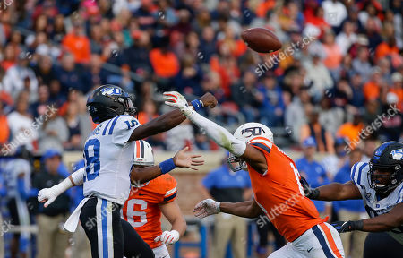Duke Blue Devils QB #18 Quentin Harris passes the ball before Virginia Cavaliers OLB #14 Noah Taylor gets to him during NCAA football game between the University of Virginia Cavaliers and the Duke Blue Devils at Scott Stadium in Charlottesville, Virginia