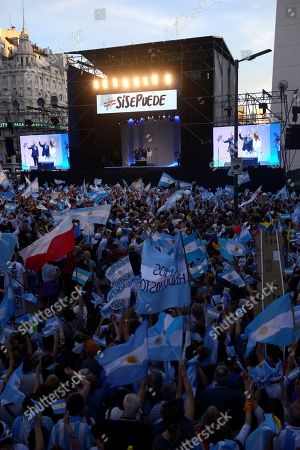 Argentine President Mauricio Macri (C), his wife Juliana Awada (R) and the vice president candidate Miguel Angel Pichetto (L) greet thousand people that attend to a march convened by Macri in the center of Buenos Aires, Argentina, 19 October 2019, in the framework of the electoral campaign. The 2019 Argentine general elections will take place on 27 October.
