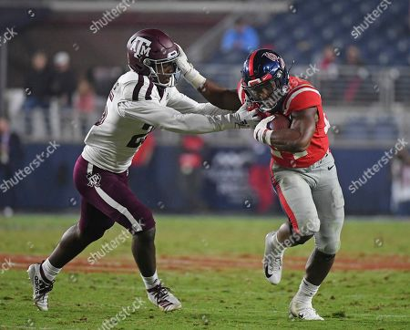 Mississippi running back Snoop Conner (24) stiff-arms Texas A&M defensive back Brian Williams (25) during the second half of an NCAA college football game in Oxford, Miss