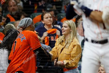Houston Rockets' Russell Westbrook, left, shakes hands with model Kate Upton, wife of Houston Astros pitcher Justin Verlander, during the fourth inning in Game 6 of baseball's American League Championship Series against the New York Yankees, in Houston