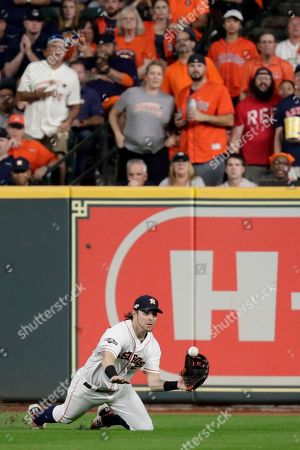 Stock Photo of Houston Astros right fielder Josh Reddick catches a fly ball hit by New York Yankees' Brett Gardner during the sixth inning in Game 6 of baseball's American League Championship Series, in Houston