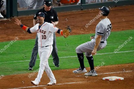 Houston Astros first baseman Yuli Gurriel celebrates after New York Yankees' Aaron Judge is forced out at first for a double play to end the top of the seventh inning in Game 6 of baseball's American League Championship Series, in Houston