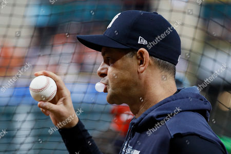 Stock Image of New York Yankees manager Aaron Boone watches batting practice before Game 6 of baseball's American League Championship Series against the Houston Astros, in Houston