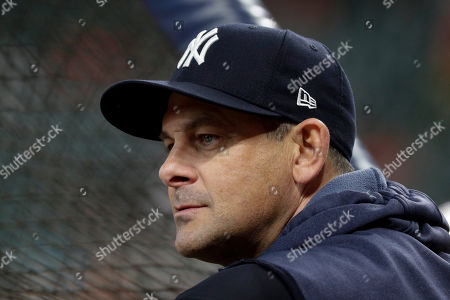New York Yankees manager Aaron Boone watches batting practice before Game 6 of baseball's American League Championship Series against the Houston Astros, in Houston