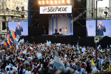 """Presidential candidate for """"Juntos Por el Cambio"""" party and Argentina's President Mauricio Macri, center, talks to supporters beside his wife Juliana Awada, right, and his running-mate Miguel Angel Pichetto, during a rally at """"9 de Julio"""" avenue in Buenos Aires, Argentina, . Argentina will hold its presidential election on Oct. 27"""
