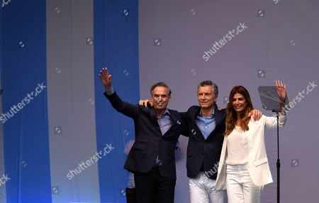"""Presidential candidate for """"Juntos Por el Cambio"""" party and Argentina's President Mauricio Macri, center, his wife Juliana Awada, right, and his running-mate Miguel Angel Pichetto, ave to supporters during a rally at """"9 de Julio"""" avenue in Buenos Aires, Argentina, . Argentina will hold its presidential election on Oct. 27"""