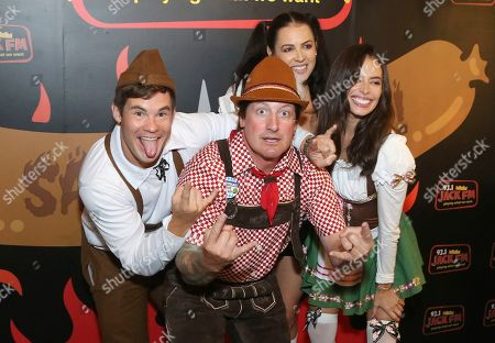 """Adam Devine, Chloe Bridges. Chloe Bridges, right, actor Adam Devine, left and guests dressed in German traditional outfits have fun at the """"Oktoberfest HB"""" at the Old World German Restaurant, in Hiuntington Beach, Calif"""