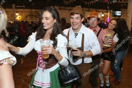 """Adam Devine, Chloe Bridges. Chloe Bridges, from left, actor Adam Devine and guests dressed in German traditional outfits have fun at the """"Oktoberfest HB"""" at the Old World German Restaurant, in Hiuntington Beach, Calif"""