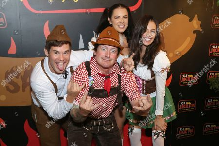 """Stock Photo of Adam Devine, Chloe Bridges. Chloe Bridges, right, actor Adam Devine, left and guests dressed in German traditional outfits have fun at the """"Oktoberfest HB"""" at the Old World German Restaurant, in Hiuntington Beach, Calif"""