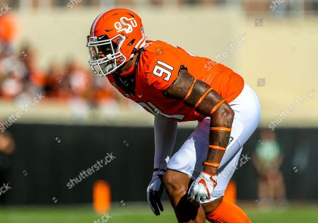 Oklahoma State defensive end Mike Scott (91) readies for a play during a football game between the Baylor University Bears and the Oklahoma State Cowboys at Boone Pickens Stadium in Stillwater, OK