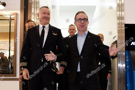 Qantas Captain Sean Golding (L) and Qantas Group CEO Alan Joyce (R) arrive at Sydney International Airport, after a record braking flight, in Sydney, Australia, 20 October 2019. Qantas completed a record-breaking commercial flight, flying from New York to Sydney without stopping. The flight took 19 hours and 15 minutes.