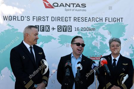 Stock Image of Qantas Captain Sean Golding (L), Qantas Group CEO Alan Joyce (C) and Manager of Fleet Operations-Boeing 787 at Qantas Lisa Norman (R), speak to the media during a press conference at Sydney International Airport in Sydey, Australia, 20 October 2019. Qantas completed a record-breaking commercial flight, flying from New York to Sydney without stopping. The flight took 19 hours and 15 minutes.