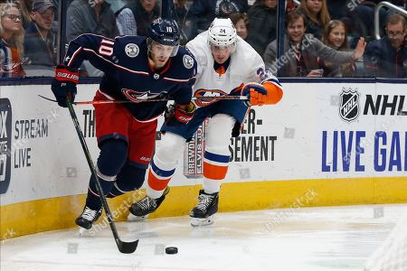 Columbus Blue Jackets' Alexander Wennberg, left, of Sweden, keeps the puck away from New York Islanders' Scott Mayfield during the second period of an NHL hockey game, in Columbus, Ohio