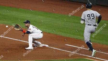 Houston Astros first baseman Yuli Gurriel takes the throw in time to get New York Yankees batter Aaron Judge (R) on a groundout in thee top of the first inning of their MLB American League Championship Series playoff baseball game six at Minute Maid Park in Houston, Texas, USA, 19 October 2019. The winner of the best-of-seven series will go on to face the Washington Nationals in the World Series.