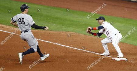 Houston Astros first baseman Yuli Gurriel (R) takes the throw in time to double up New York Yankees baserunner Aaron Judge (L) to end the top of the seventh inning of their MLB American League Championship Series playoff baseball game six at Minute Maid Park in Houston, Texas, USA, 19 October 2019. The winner of the best-of-seven series will go on to face the Washington Nationals in the World Series.