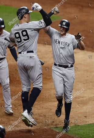 New York Yankees batter DJ LeMahieu (R) celebrates with teammate Aaron Judge (L) after hitting a game-tying  two-run home run in the top of the ninth inning of their MLB American League Championship Series playoff baseball game six at Minute Maid Park in Houston, Texas, USA, 19 October 2019. The winner of the best-of-seven series will go on to face the Washington Nationals in the World Series.