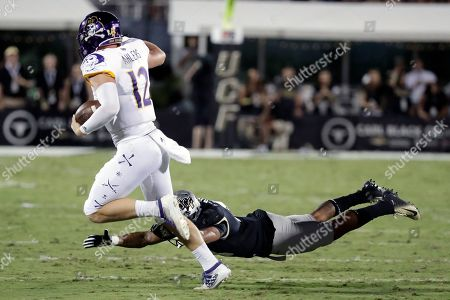 Holton Ahlers, Jordan Hayes. East Carolina quarterback Holton Ahlers (12) scrambles past Central Florida defensive back Jordan Hayes during the first half of an NCAA college football game, in Orlando, Fla
