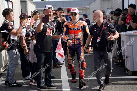 Spanish MotoGP rider Jorge Lorenzo (C, right) of Repsol Honda Team walks to his garage before the Warm Up session of the Japanese Motorcycle Grand Prix at Twin Ring Motegi race track in Motegi, Tochigi Prefecture, Japan, 20 October 2019.