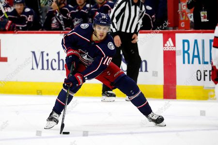 Columbus Blue Jackets' Alexander Wennberg (10) moves the puck against the Carolina Hurricanes during the first period of an NHL hockey game, in Raleigh, N.C