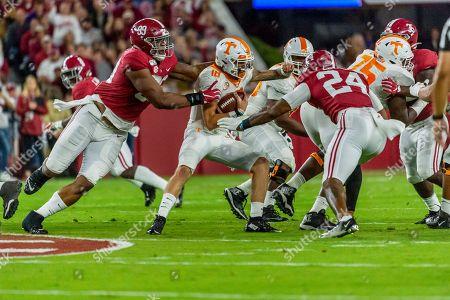 Alabama defensive lineman Raekwon Davis (99) pressures Tennessee quarterback Brian Maurer (18) during the first half of an NCAA college football game, in Tuscaloosa, Ala