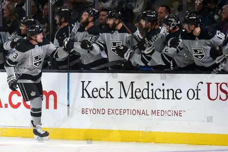 Stock Photo of Los Angeles Kings center Tyler Toffoli, left, celebrates with teammates after scoring against the Calgary Flames during the first period of an NHL hockey game in Los Angeles