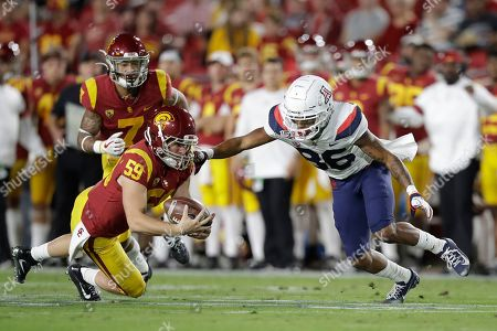 Damon Johnson, Stanley Berryhill III. Southern California's Damon Johnson, left, recovers a fumble by Arizona's Stanley Berryhill III (86) on a punt during the first half of an NCAA college football game, in Los Angeles