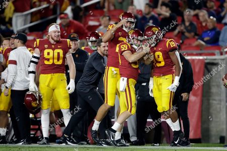 Southern California's Damon Johnson (59) celebrates with teammates after recovering a fumble on a punt during the first half of the team's NCAA college football game against Arizona, in Los Angeles
