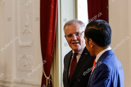 Indonesian President Joko Widodo (R) and Australian Prime Minister Scott Morrison (L) walk through the presidential palace in Jakarta, Indonesia, 20 October 2019. Morrison is in Jakarta to attend Widodo's swearing-in ceremony. The Indonesian president is set to be sworn in for his second and final term after winning the April 2019 presidential election.
