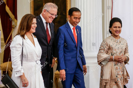 Australian Prime Minister Scott Morrison (2-L) and his wife, Jennifer Morrison (L), Indonesian President Joko Widodo (2-R) and Indonesian First Lady Iriana Joko Widodo (R), walk around the presidential palace in Jakarta, Indonesia, 20 October 2019. Morrison is in Jakarta to attend Widodo's swearing-in ceremony. The Indonesian president is set to be sworn in for his second and final term after winning the April 2019 presidential election.