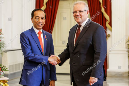 Indonesian President Joko Widodo (L) shakes hands with Australian Prime Minister Scott Morrison (R) at the presidential palace in Jakarta, Indonesia, 20 October 2019. Morrison is in Jakarta to attend Widodo's swearing-in ceremony. The Indonesian president is set to be sworn in for his second and final term after winning the April 2019 presidential election.