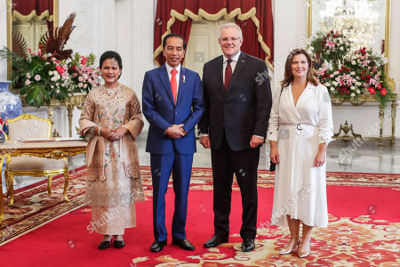 (L-R) Indonesian First Lady Iriana Joko Widodo, Indonesian President Joko Widodo, Australian Prime Minister Scott Morrison and his wife, Jennifer Morrison, pose for a photo at the presidential palace in Jakarta, Indonesia, 20 October 2019. Morrison is in Jakarta to attend Widodo's swearing-in ceremony. The Indonesian president is set to be sworn in for his second and final term after winning the April 2019 presidential election.