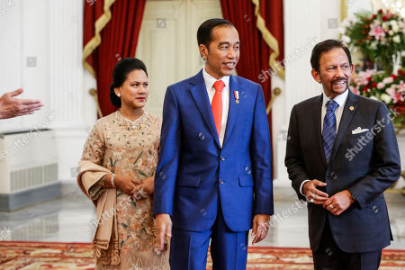 (L-R) Indonesian First Lady Iriana Joko Widodo, Indonesian President Joko Widodo and Sultan of Brunei, Hassanal Bolkiah, walk through the presidential palace in Jakarta, Indonesia, 20 October 2019. The Indonesian president is set to be sworn in for his second and final term after winning the April 2019 presidential election.
