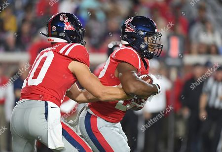 Mississippi quarterback John Rhys Plumlee (10) hands the ball off to running back Scottie Phillips (22) during the first half of an NCAA college football game against Texas A&M in Oxford, Miss