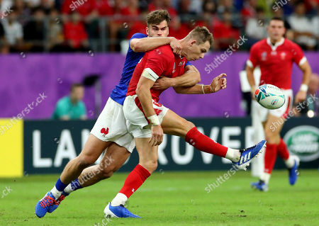 Wales vs France. France's Damian Penaud and Liam Williams of Wales