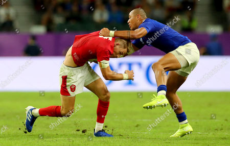 Wales vs France. Wales' Liam Williams with Gael Fickou of France