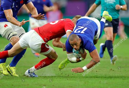 France's Gael Fickou, right, is tackled by Wales' Liam Williams during the Rugby World Cup quarterfinal match at Oita Stadium in Oita, Japan