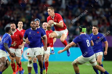 Wales' Liam Williams catches the ball during the Rugby World Cup quarterfinal match against France at Oita Stadium in Oita, Japan